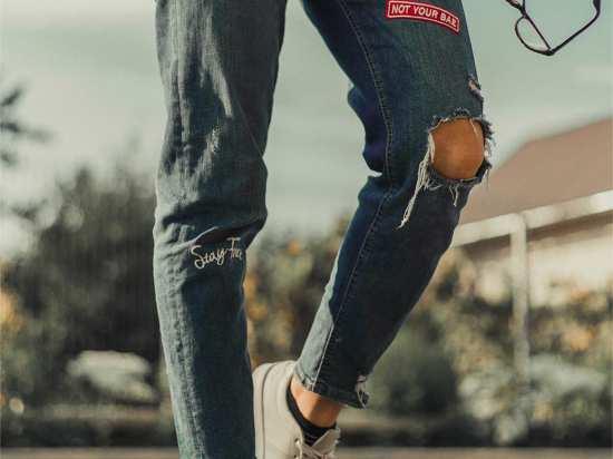 111F patched jeans with fancy badges
